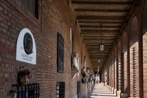 red brick arcade with commemorative busts and plaques, Szeged, Hungary
