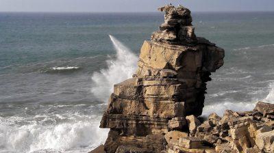 Wave splashing against sea stack near Cabo Carvoeiro Portugal