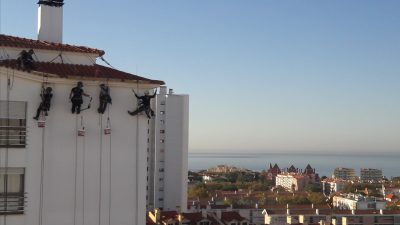 House painters abseiling on high rise in Lisbon suburb