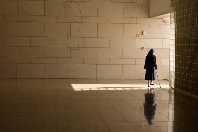 Nun with walking stick in Basilica in Fatima Portugal