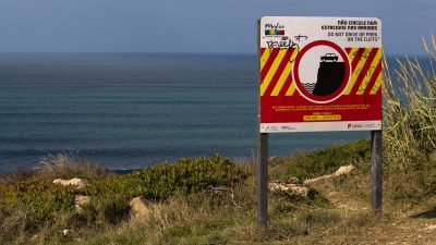 warning sign on cliff top, do not park