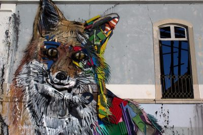 Mural of fox made of old scrap on facade of burnt out house, Santos, Lisbon, Portugal