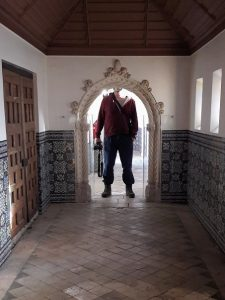 man standing at arched doorway, too tall by a head to enter, scale model of palace, Portugal dos Pequenitos, Coimbra