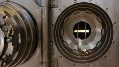 Seamus the Seagull in bank vault containing gold bar in Money Museum Lisbon