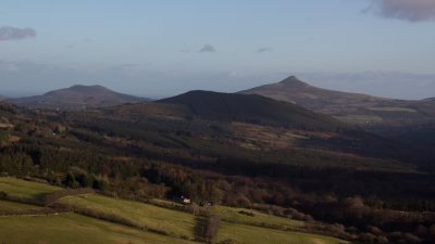 scenery with fields in foreground, three hill tops in background, County Wicklow, Ireland