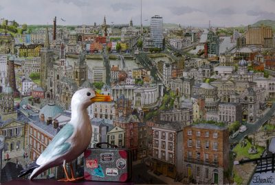 Seamus the Seagull with suitcase covered in labels standing in front of painting of Dublin city, Ireland