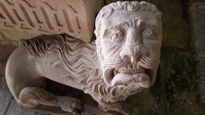 Carved stone figure of lion guarding tomb, Coimbra, Portugal