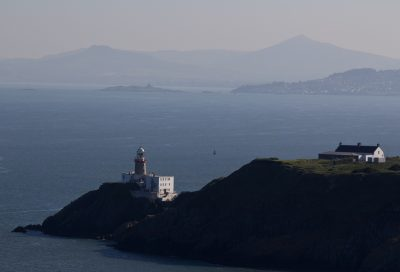 house and lighthouse on peninsula, island, coastline and mountain range in background, Baily Lighthouse, Howth Head, County Dublin