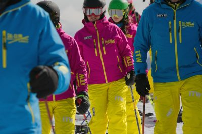 close-up of skiers in brightly coloured skiing outfits, Hinterthal Maria Alm