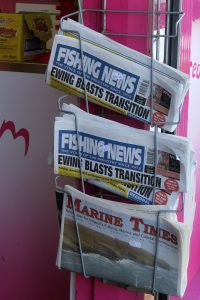 rack at shop entrance holding newspapers, Fishing News, Marine Times, Howth, County Dublin